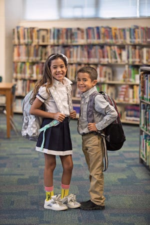 Taylor Reis, 8, and Tyler Reis, 6, model for the August 2018 issue of Southwest Florida Parent & Child magazine at J. Collin English Elementary School in North Fort Myers.