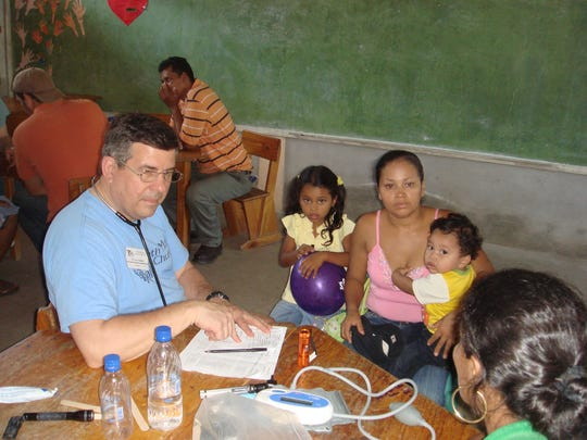 Dr. Gary Goforth examines a family in Honduras.