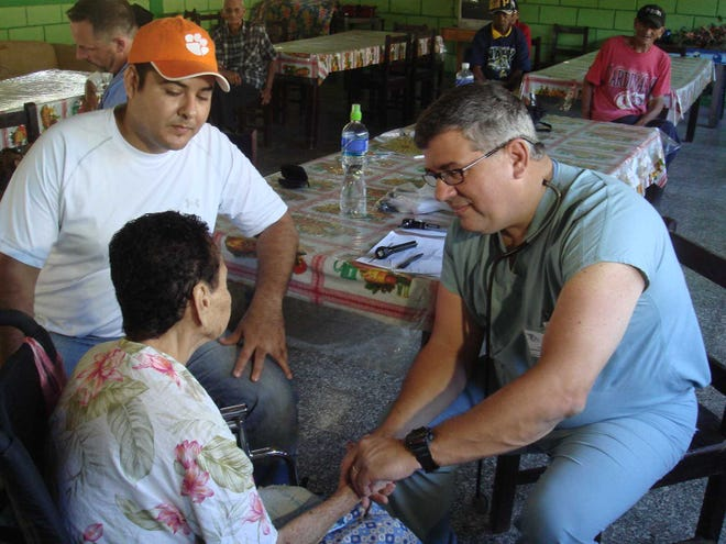 Dr. Gary Goforth attends to a patient in a Honduras nursing home. Goforth is one of many Southwest Florida doctors who travel on missions to help those in need. The doctors say they do it for many reasons. Some do it for the healing and others for the spirituality.