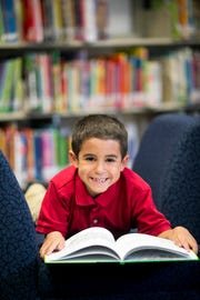 Tyler Reis, 6, models for the August 2018 issue of Southwest Florida Parent & Child magazine at J. Collin English Elementary School in North Fort Myers.