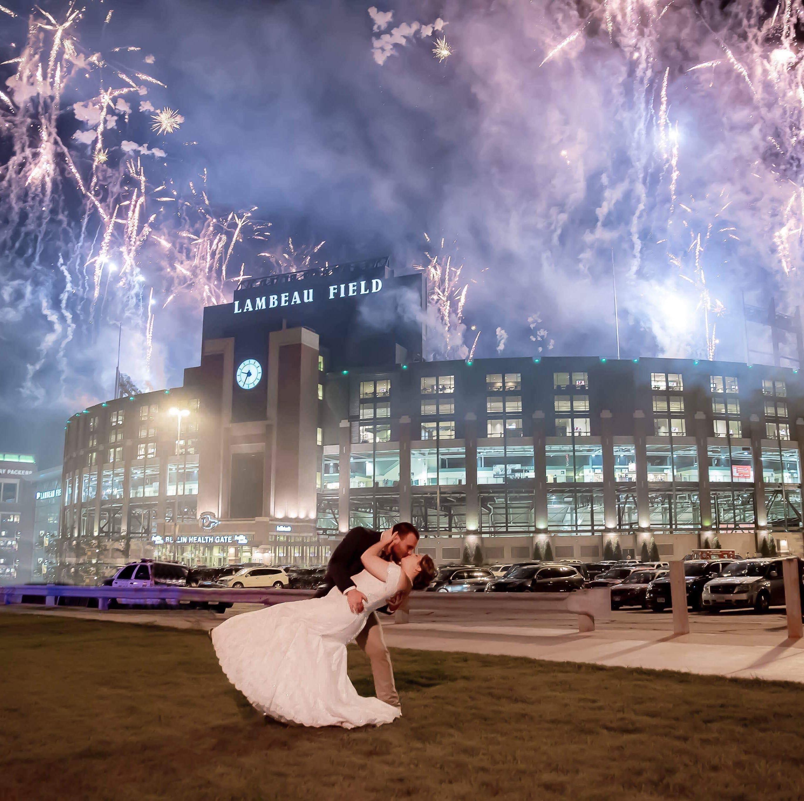Newlyweds get fairy-tale photo finish to wedding day with fireworks outside Lambeau