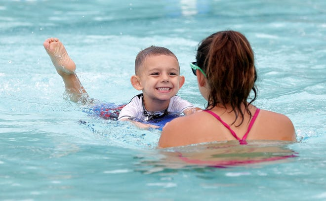 Abram Aude, 4, participates in a swim lesson with guidance from instructor Sarah Matheson on Tuesday at Legion Pool in De Pere.