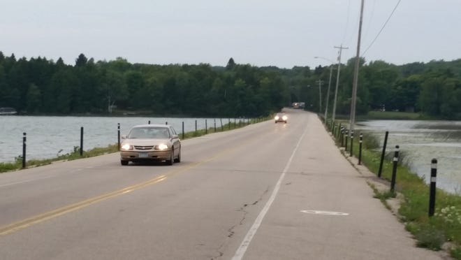 Fishermen standing along the edge of Door County E have recently found themselves in danger when cars fail to stay between the lines. The Town Chairman hopes that rumble strips will remedy this problem.