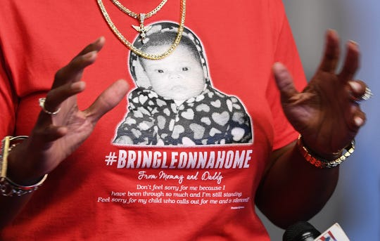 The image of missing child Leonna Wright is displayed on the t-shirt of Greenville activist Traci Fant during a press conference Tuesday, August 7, 2018 to ask the community for any new information they may have on Wright who disappeared from a Pendleton apartment complex in 2015.