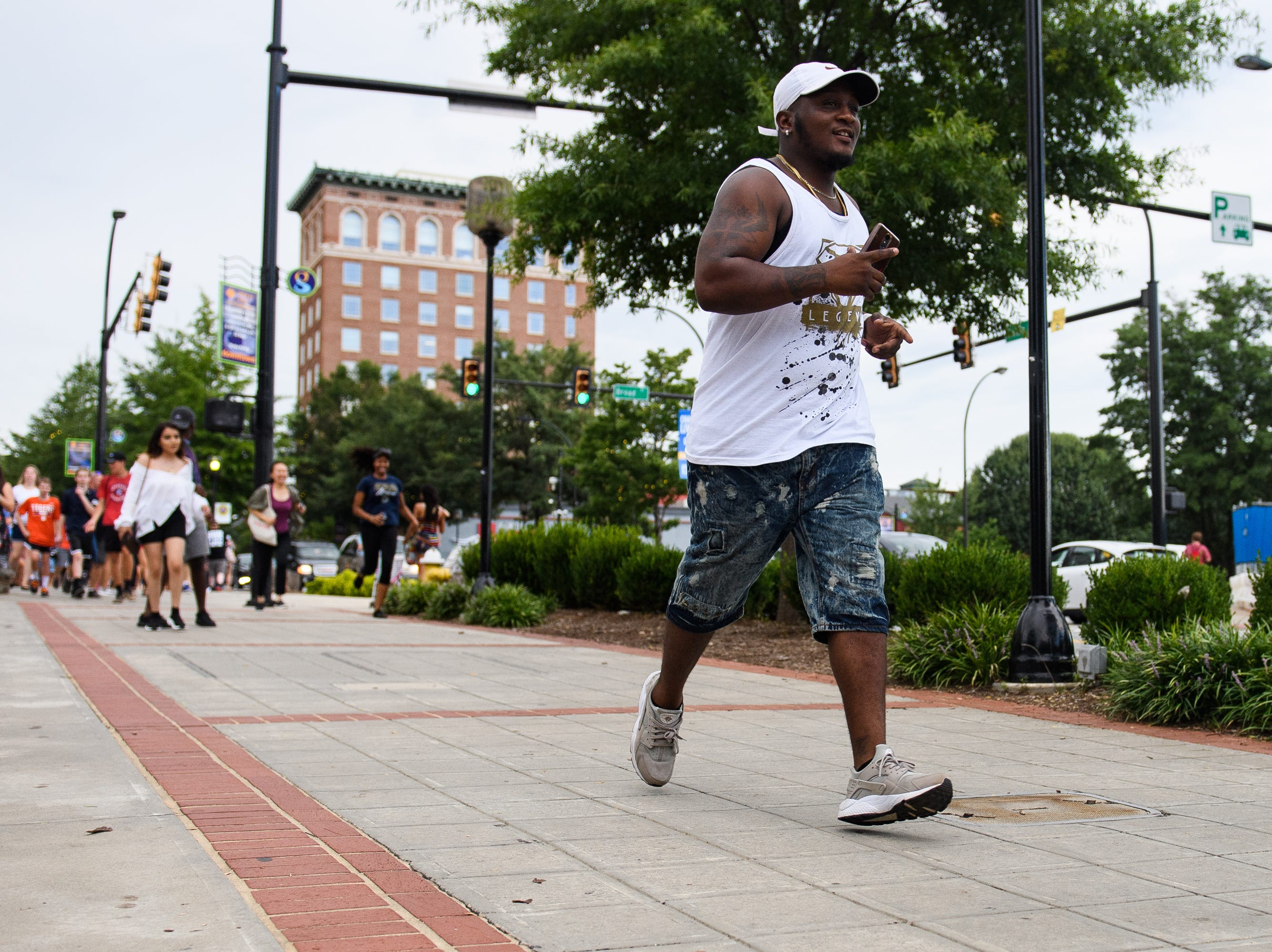 A man runs to try to find a cash prize during the Breakout Greenville Treasure Hunt in downtown Greenville on Tuesday, Aug. 7, 2018.