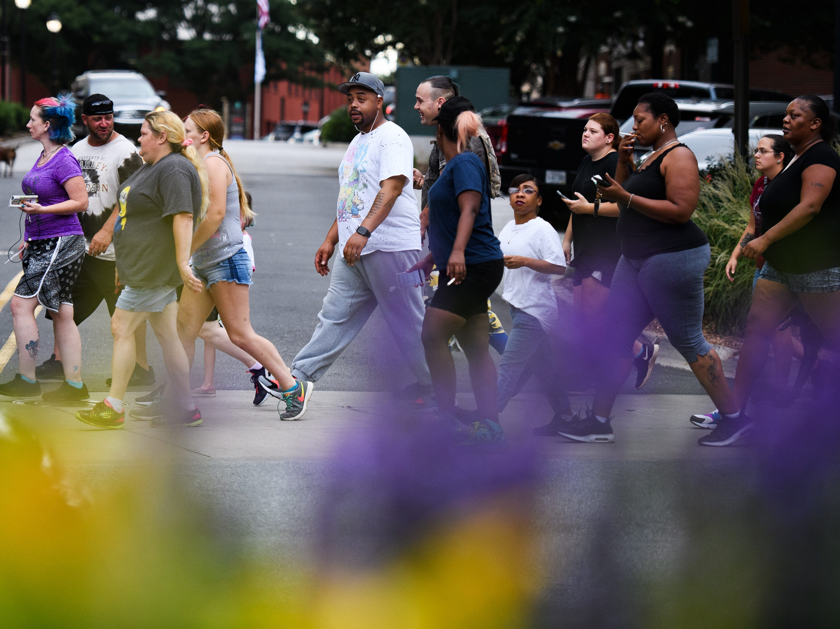 More than 1,000 people participated in the Breakout Greenville Treasure Hunt in downtown Greenville on Tuesday, Aug. 7, 2018. Breakout hid $2,000 in cash throughout the city for people to find.