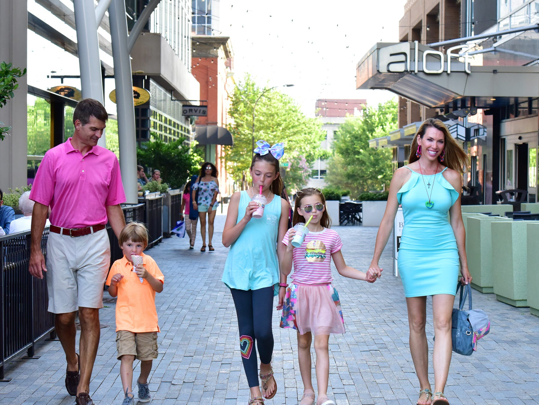 The Hewitt Family, Jay, Thomas, 4, Janna, 11, Ainslie, 8, and Anna walk togther in downtown Greenville.