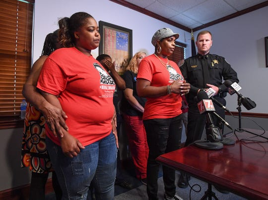 Greenville activist Traci Fant, center, along with Kiara Sullivan, right, and Anderson County Sheriff Chad McBride asks the community during a press conference Tuesday, August 7, 2018 for any new information they may have on Sullivan's daughter Leonna Wright who disappeared from a Pendleton apartment complex in 2015.