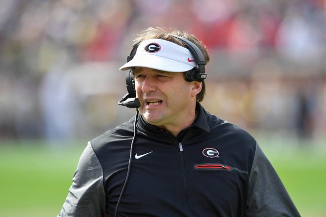 In this 2017 file photo, Georgia Bulldogs head coach Kirby Smart shown on the sideline against the Georgia Tech Yellow Jackets during the first half at Bobby Dodd Stadium.