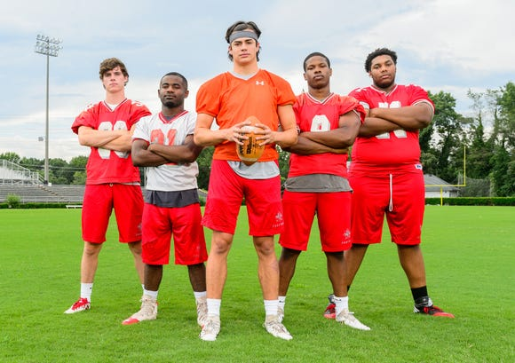 From left, Eric Reece, Trey Berry, Cason Whitmire, Jevon Carter and Jaheim Scott will lead a close-knit Wade Hampton team into the season.