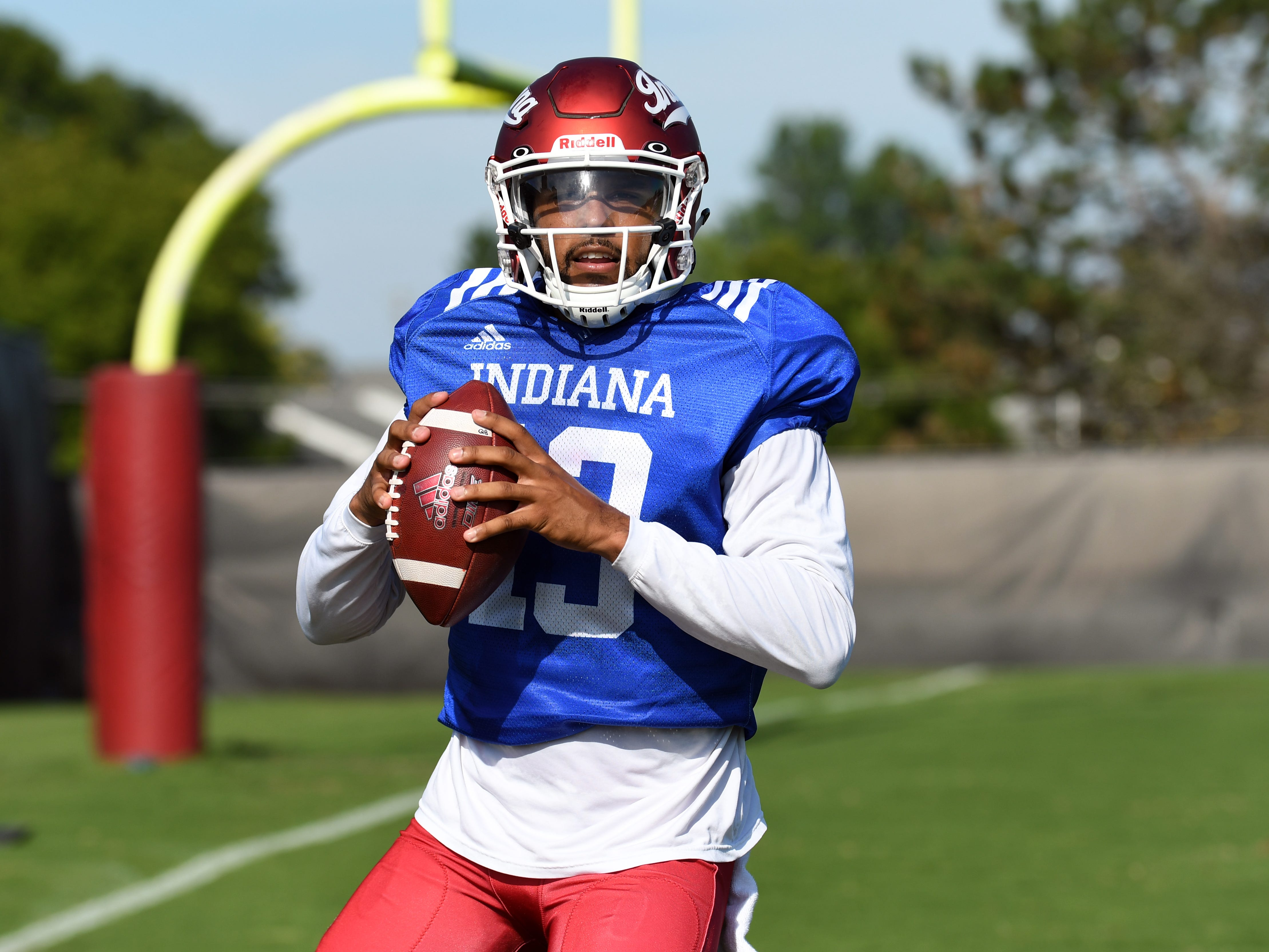 Indiana Hoosiers quarterback Brandon Dawkins (13) drops back during a drill during practice at Mellencamp Pavilion in Bloomington, Ind., on Monday, August 6, 2018.