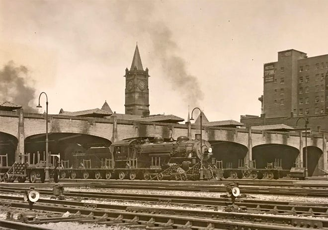 A train leaves Union Station in the 1920s.