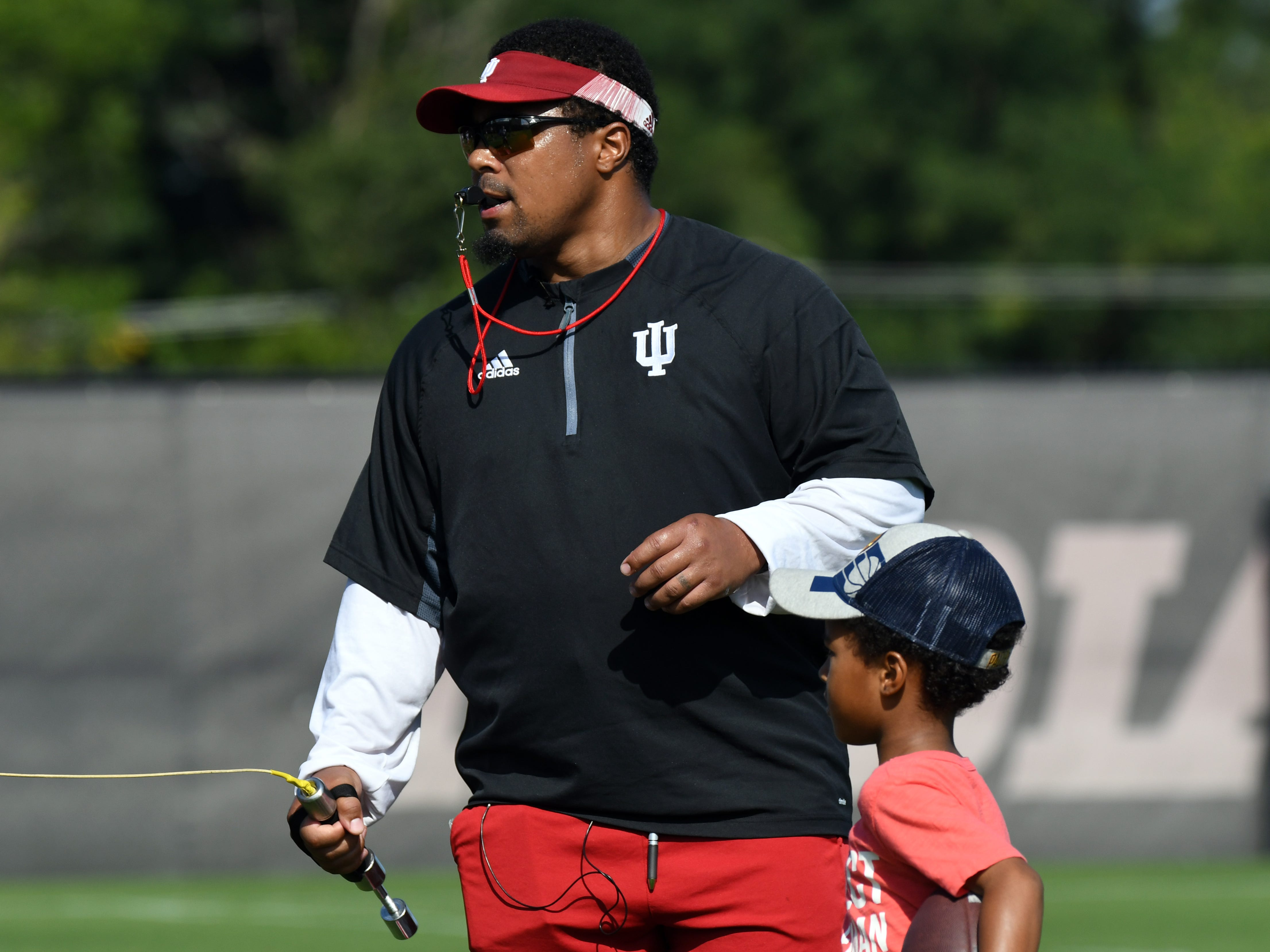 Indiana Hoosiers Assistant Head Coach Mike Hart coaches the running backs during practice at Mellencamp Pavilion in Bloomington, Ind., on Monday, August 6, 2018.