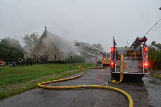 Indianapolis firefighters respond to a fire at Our Savior Lutheran Church on Aug. 7, 2018.