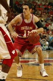 Errek Suhr, of Indiana University, works the ball near the end of their 61-56 victory during the Big Ten Tournament in 2006.  (Robert Scheer/The Indianapolis Star)