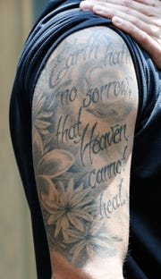 "Matt Heskett, Employer Services Coordinator for Fairbanks Alcohol and Drug Addiction Treatment Center shows off his tattoo which references his own journey overcoming addiction, and the death of his girlfriend Jasmine Wethington, Thursday Aug. 2, 2018. His tattoo features jasmine leaves and the words ""Earth hath no sorrow, that heaven can't heal,"" a favorite quote of Jasmine's who passed away in 2017."