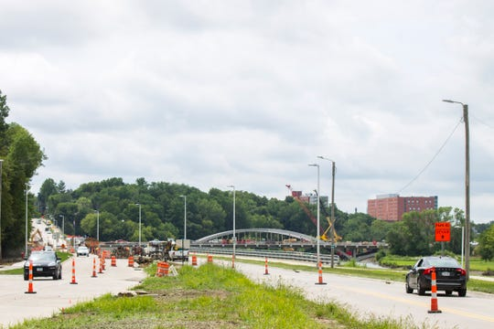 "Traffic flows while construction continues along Dubuque Street while crews work to finish the ""Gateway Project"" on Tuesday, Aug. 7, 2018, in Iowa City, Iowa. The project began in 2016 and raised Dubuque Street 10 feet between Foster and Kimball roads."