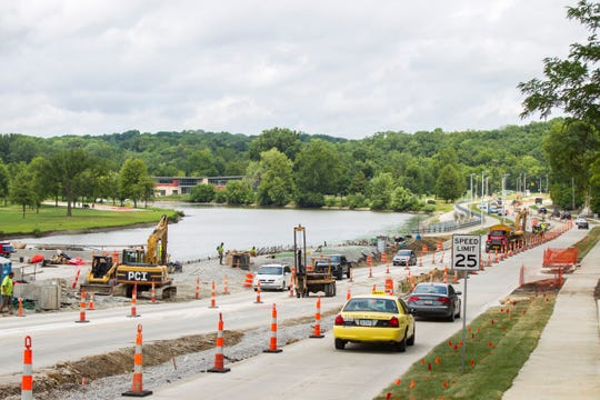 """Traffic flows while construction continues along Dubuque Street while crews work to finish the """"Gateway Project"""" on Tuesday, Aug. 7, 2018, in Iowa City, Iowa. The project began in 2016 and raised Dubuque Street 10 feet between Foster and Kimball roads."""