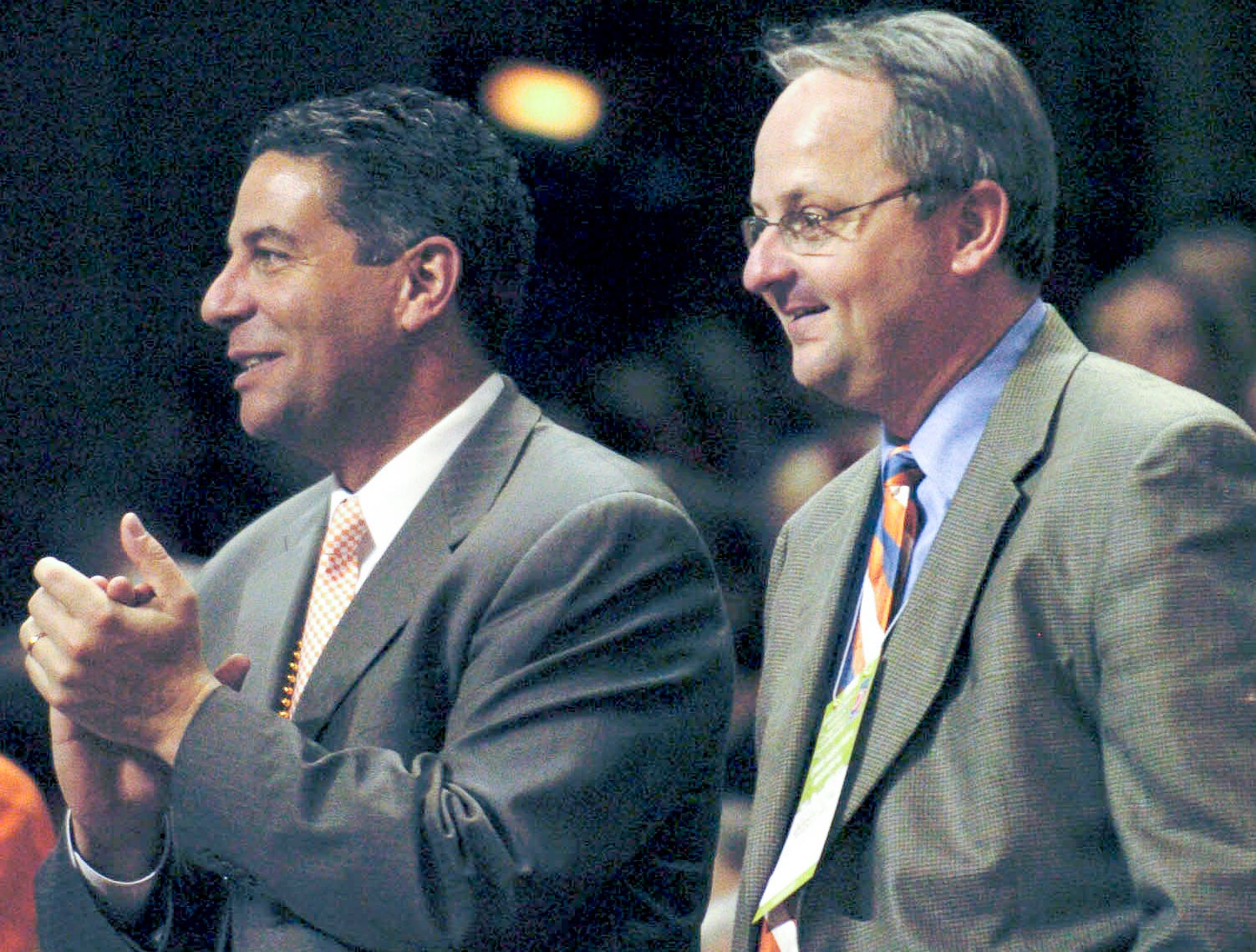 Tennessee men's basketball coach Bruce Pearl, left, watches the Lady Vols play Rutgers with UT Athletics Director Mike Hamilton March 29, 2005 at Thompson-Boling Arena. Pearl just signed a five-year UT contract worth $800,000 annually after Buzz Peterson was fired March 13.