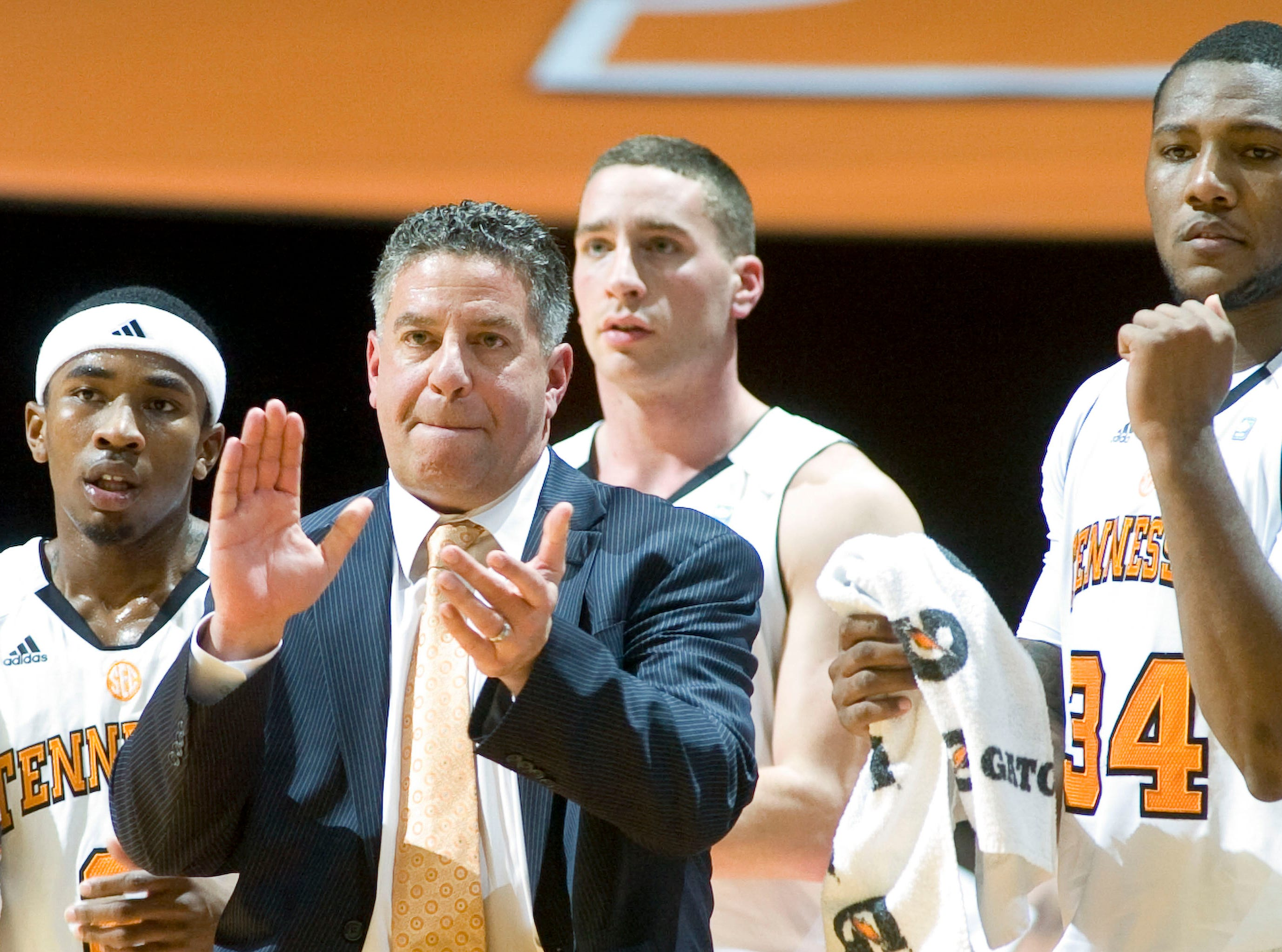 Tennessee coach Bruce Pearl cheers on his team with from left, Melvin Goins, Steven Pearl, and Jeronne Maymon. The USC Trojans defeat the Tennessee Volunteers 65-64 at Thompson-Boling Arena on Tuesday, December 21, 2010.