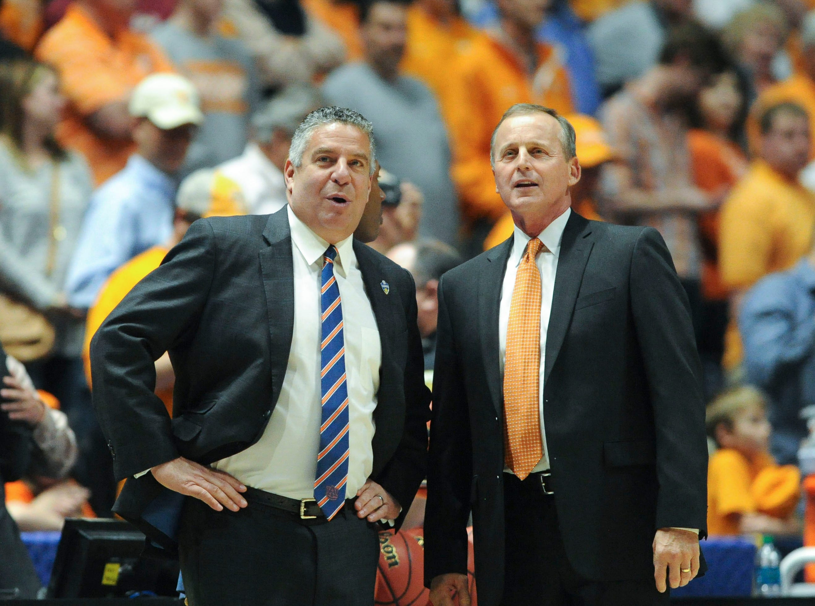 Auburn head coach Bruce Pearl and Tennessee head coach Rick Barnes chat at mid court before an SEC tournament game at Bridgestone Arena in Nashville, Tenn. on Wednesday, March 9, 2016. Tennessee won 97-59. (ADAM LAU/NEWS SENTINEL)