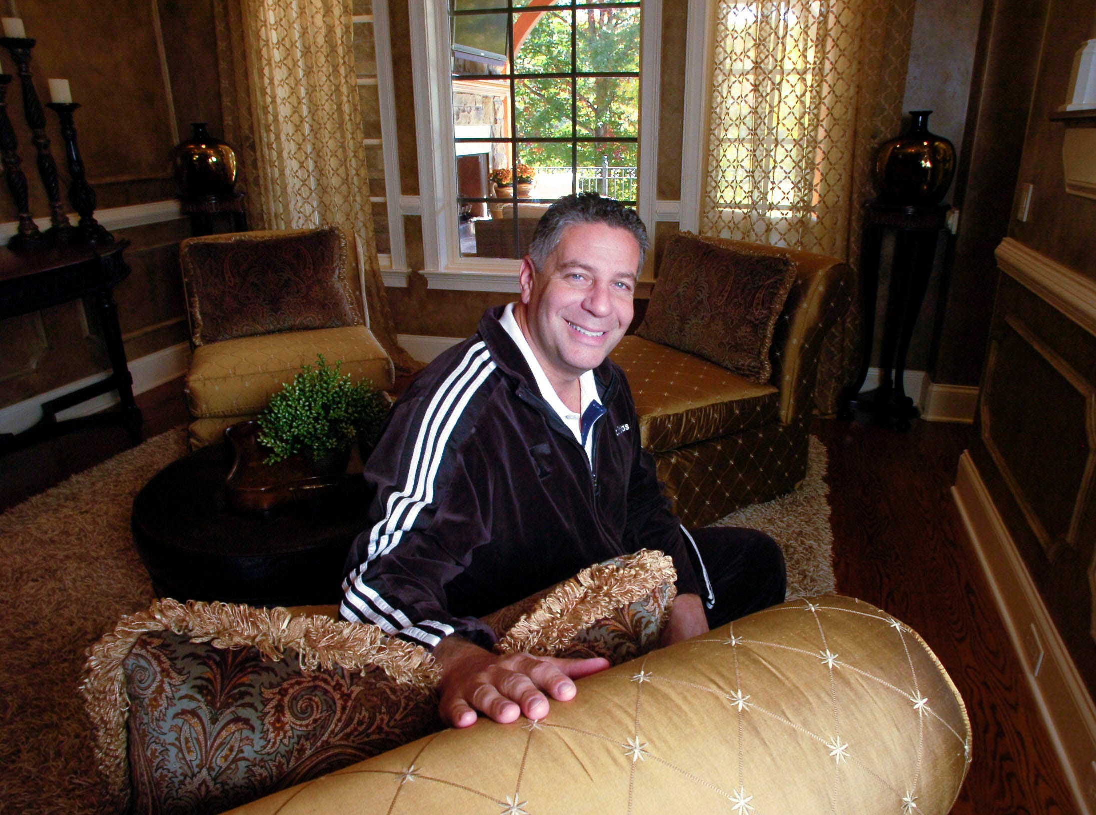 University of Tennessee basketball coach Bruce Pearlsits in the formal living room of his first home in Gettysvue in 2008.