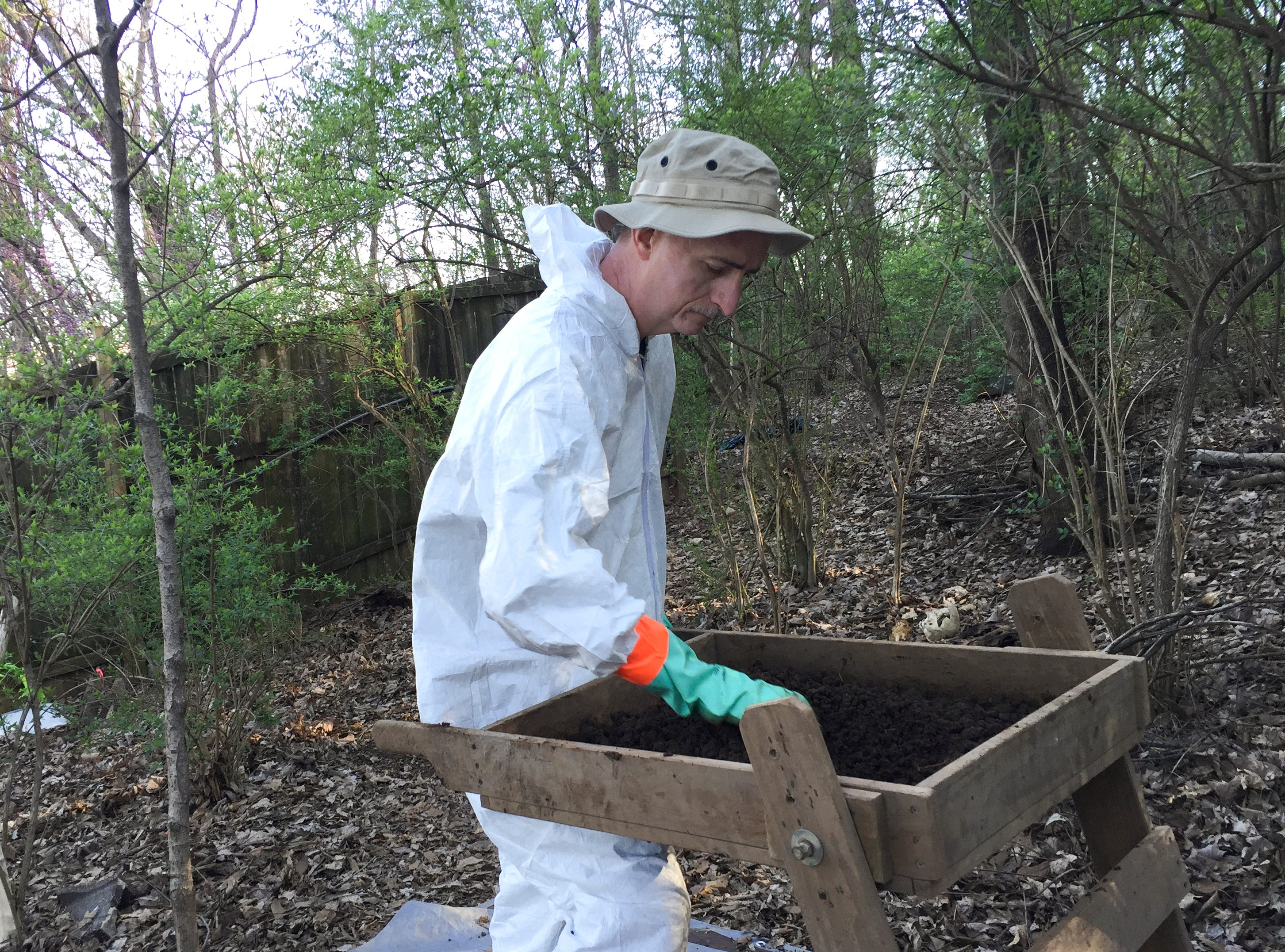Robert Weiderhold, who works at the FBI Laboratory in Quantico, VA, sifts dirt for evidence of human remains during a training for FBI agents at the University of Tennessee Forensic Anthropology Center, often called the body farm, on Thursday, March 17, 2016. FBI agents from across the country are attending the weeklong training.