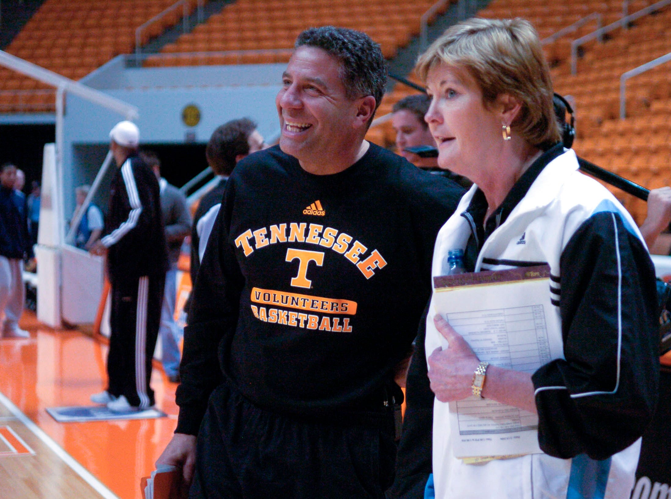 Tennessee basketball coaches Bruce Pearl and Pat Summitt say hello as the men's team enters the court for a walk through before the game against Auburn in 2006.
