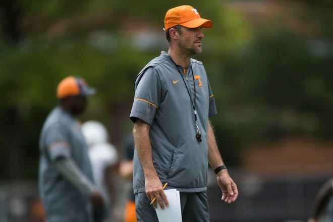 Offensive coordinator and quarterbacks coach Tyson Helton coaches during preseason practice at University of Tennessee Tuesday, Aug. 7, 2018.