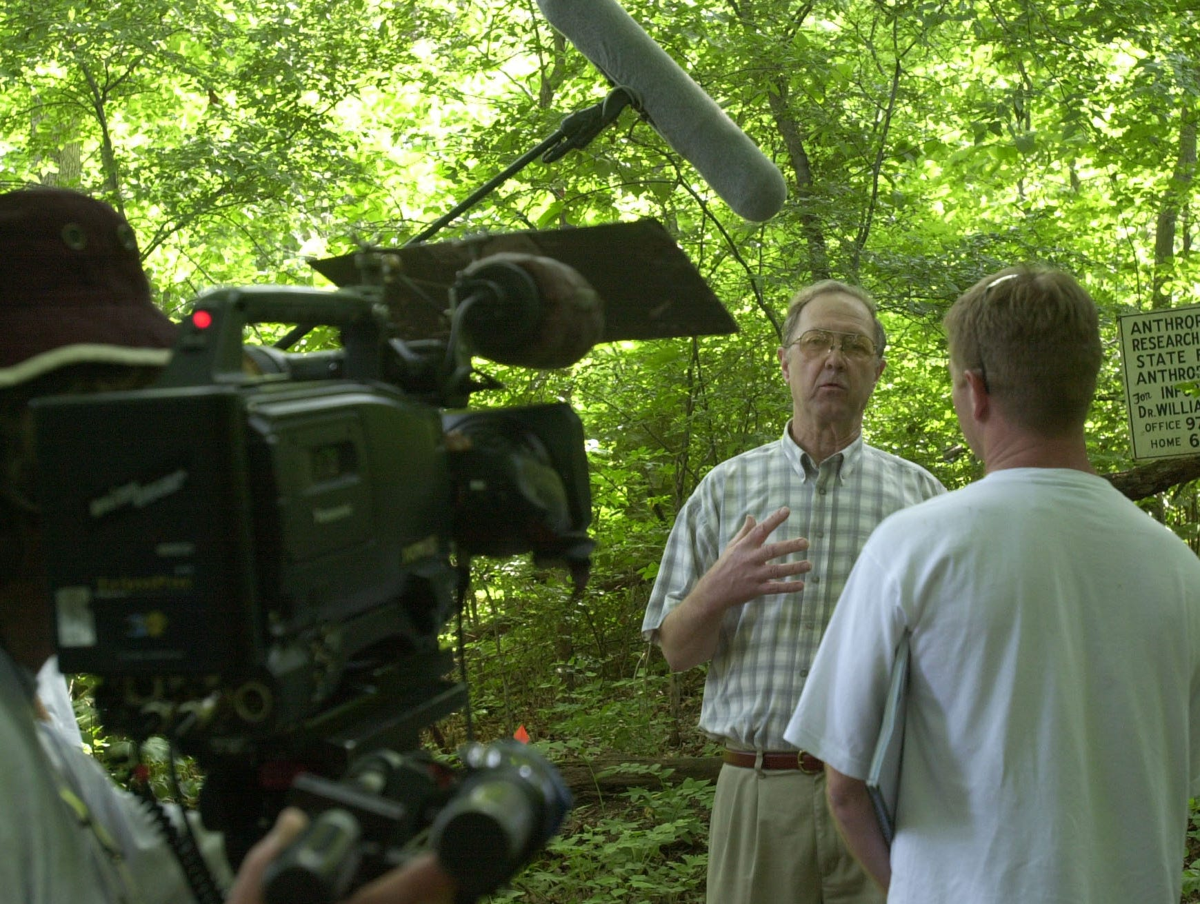 """News-Sentinel photo by Michael Patrick.  Dr. Richard Jantz is interviewed at the UT body farm by a New Zealand film crew for a two-part Learning Channel special about the human body.  Glenn Krawczyk said the working title of the show is """"Planet Human"""" and it is generally about the human eco-system."""