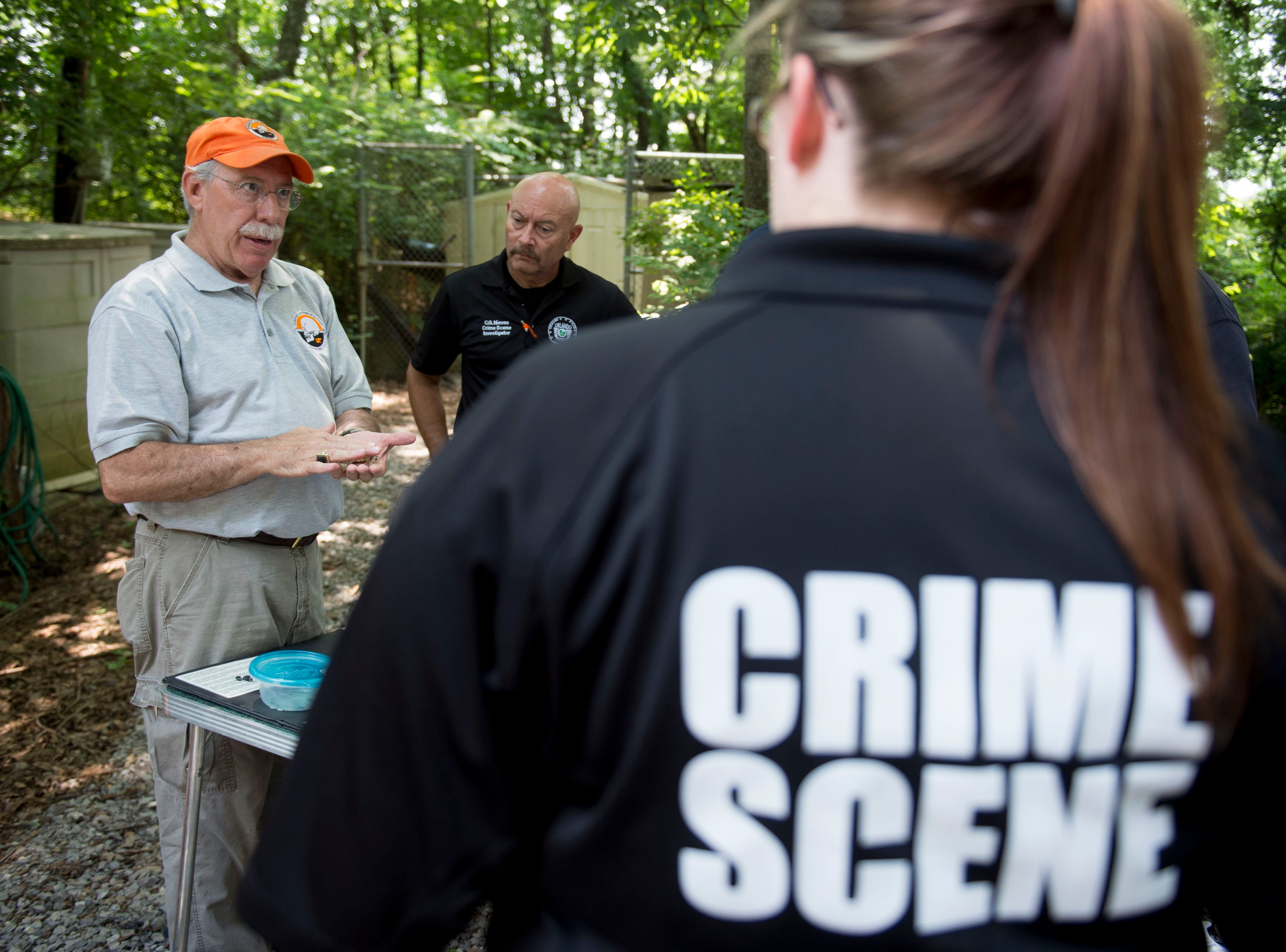 Dr. Randy Parce, a forensic odontologist, teaches a group of law enforcement professionals in using dental information for police investigations. Thirteen law enforcement agencies from across the United States are taking part in a weeklong training course at the University of Tennessee's Forensic Anthropology Center.