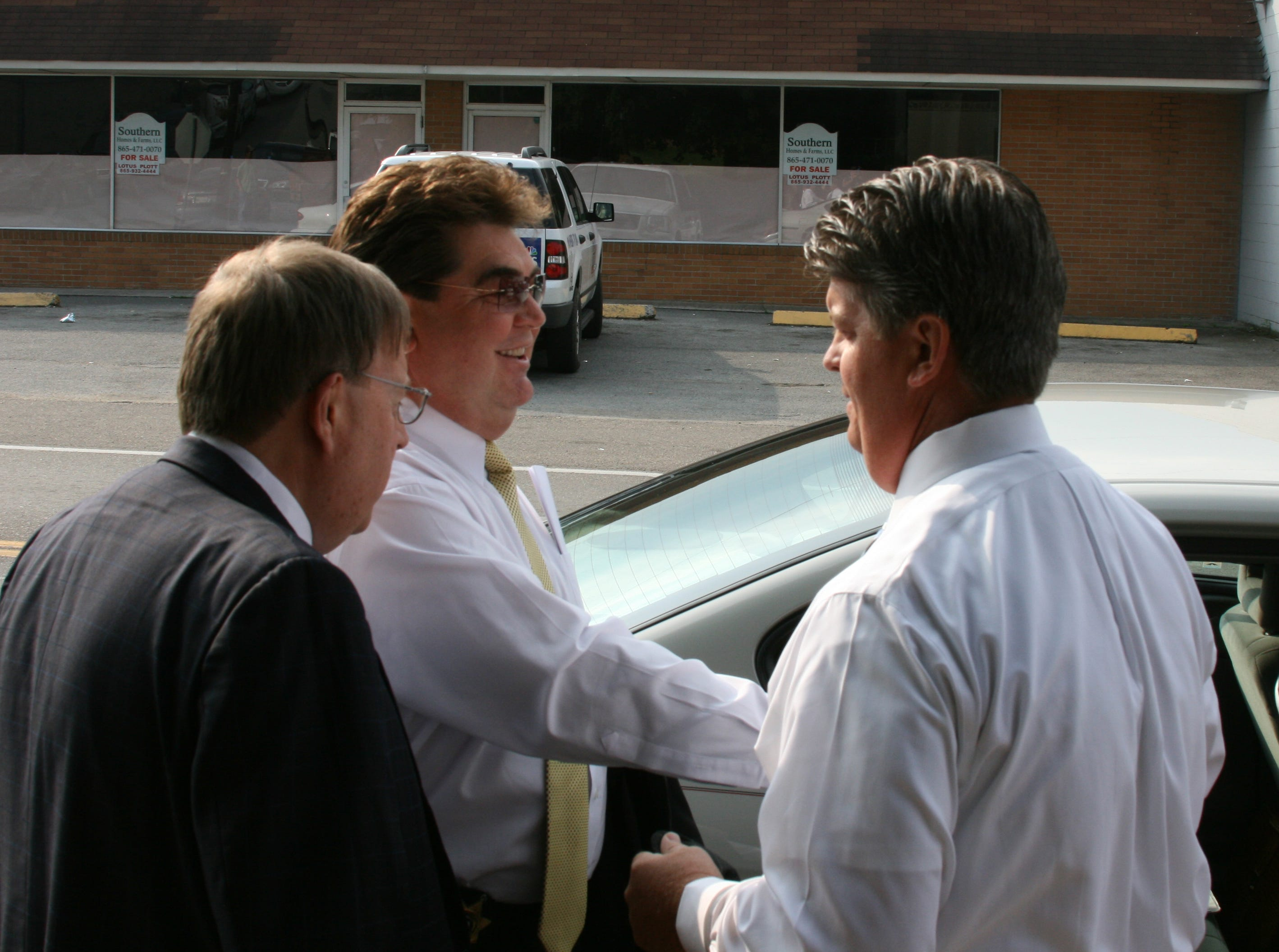 Claiborne County Sheriff David Ray, center, with attorneys John T. Milburn Rogers, left, and David Stanifer leave after a hearing in Hancock County Criminal Court Wednesday in Sneedville, Tenn. Ray was placed on a two-year pre-trial diversion program and ordered to perform 250 hours of community service in connection with sexual assault, statutory rape and statutory rape by an authority figure charges. Ray is accused of raping a girl on a deer-hunting trip in Hancock County in 2006, when she was 17, and on an earlier occasion in 2005, when she was 15.