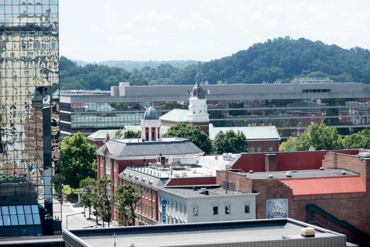 Government buildings can be seen from the rooftop seating at the Hyatt Place Rooftop Bar in Knoxville, Tennessee on Tuesday, August 7, 2018. The rooftop offers views of downtown, mountains and a selection of drinks and snacks at the bar.