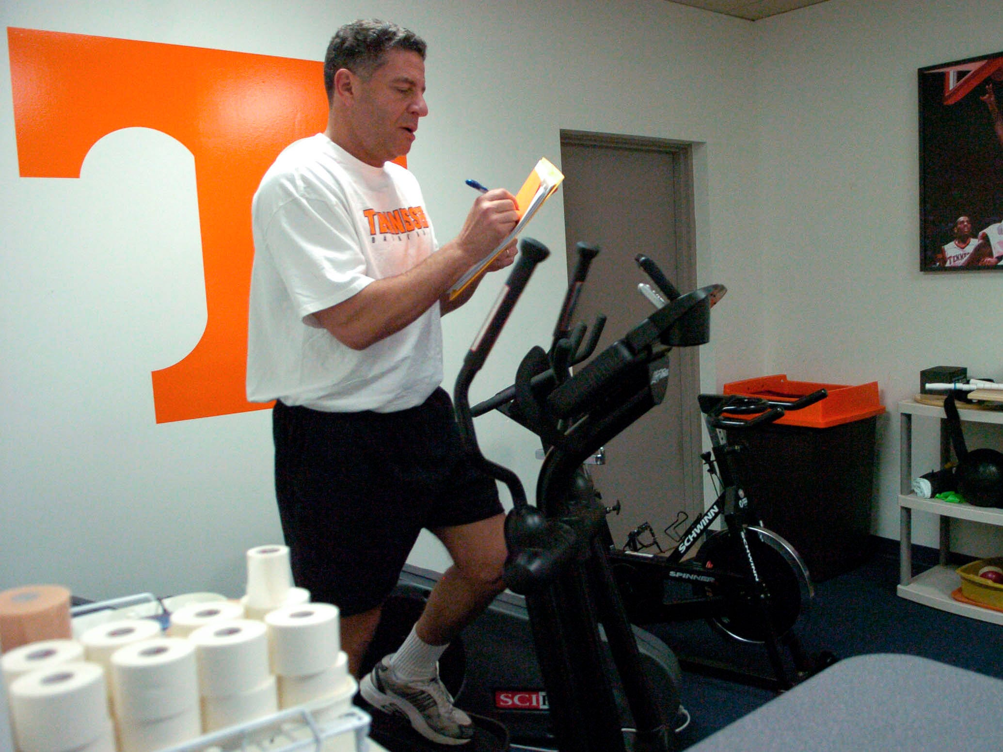 Bruce Pearl works out in the training room and takes notes while watching tapes of the Tennessee and Auburn basketball game in 2006.