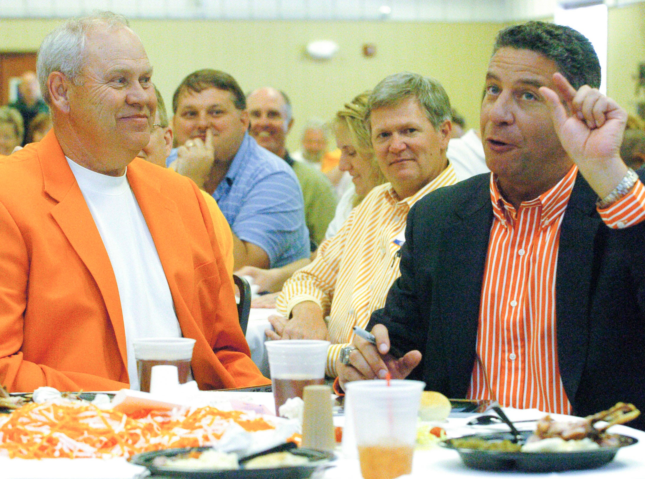 Bruce Pearl's chest-painting stunt at a Lady Vols basketball game last season continued to get chuckles Monday at the Big Orange Caravan stop in Sevierville in 2007 while seated with Phillip Fulmer. Pearl quipped that just a little exposure by him has led to a lot of exposure for Tennessee.