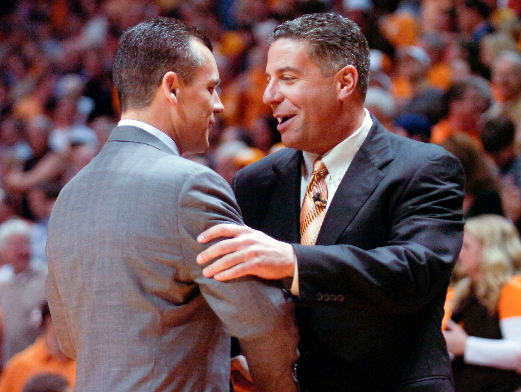 Tennessee head coach Bruce Pearl talks with Florida head coach Billy Donovan before the game at Thompson-Boling Arena in 2008.