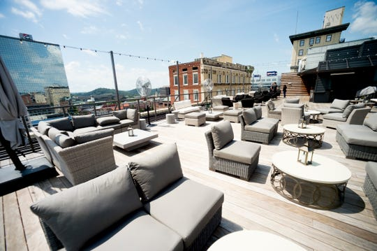 Rooftop seating at the Hyatt Place Rooftop Bar in Knoxville, Tennessee on Tuesday, August 7, 2018. The rooftop offers views of downtown, mountains and a selection of drinks and snacks at the bar.