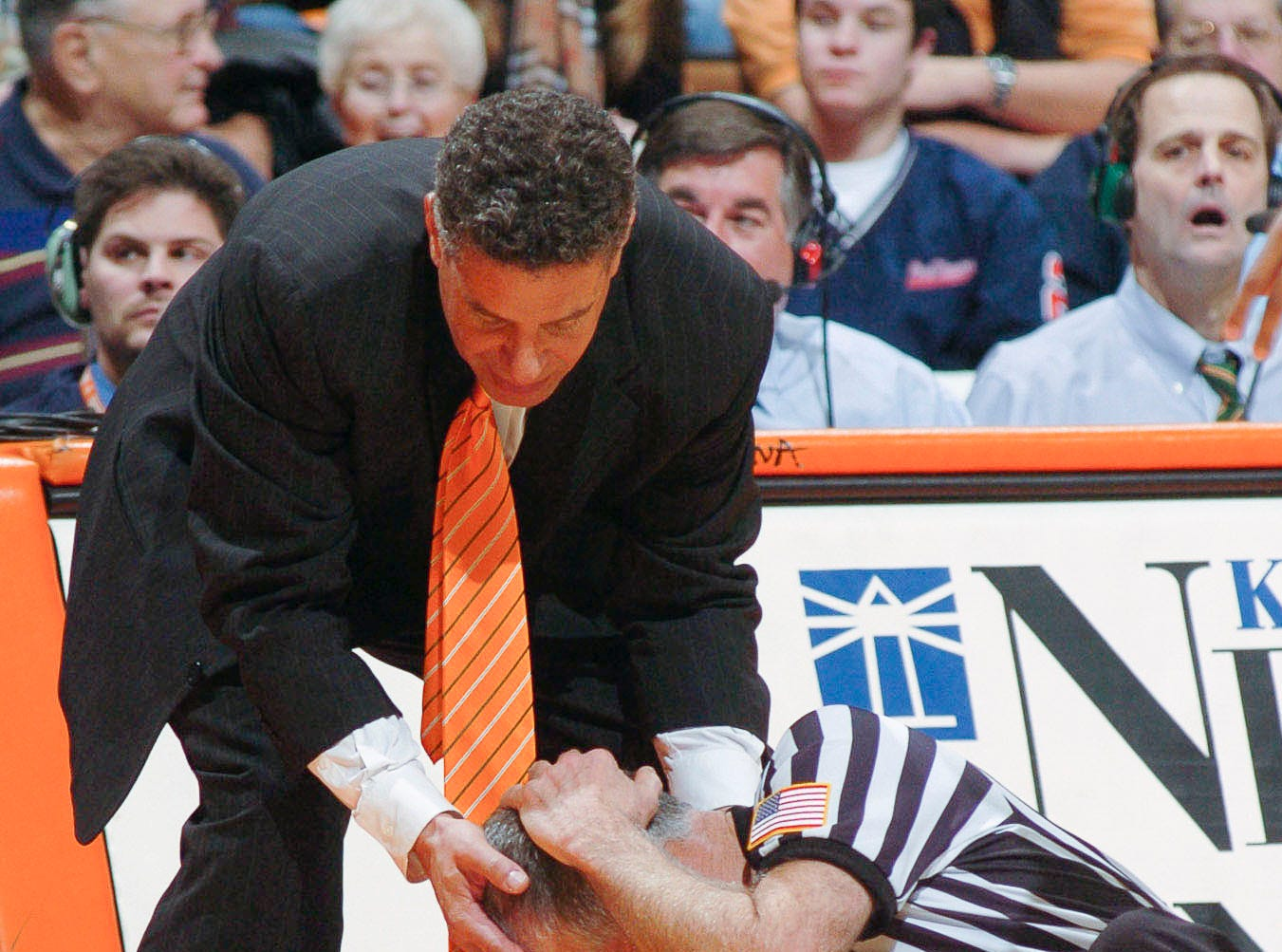 "Tennessee men's basketball coach Bruce Pearl holds official Tom Lopes' head after he was knocked down by UT player JaJuan Smith (2) during UT""s game against Lipscomb in Thompson-Boling Arena in 2005."