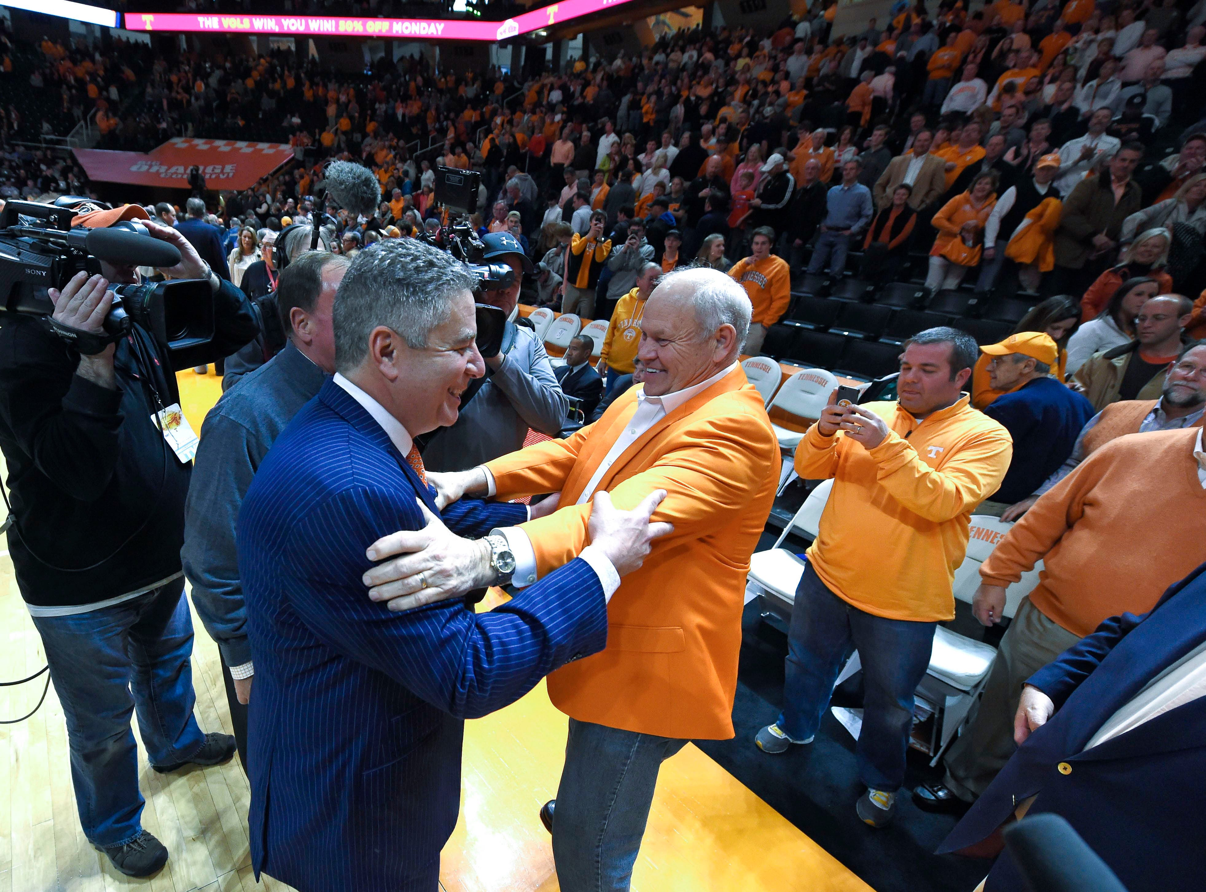 Auburn head coach Bruce Pearl gets a hug from former Tennessee football head coach Phillip Fulmer following Auburn's 71-63 loss to Tennessee at Thompson-Boling Arena in Knoxville on Saturday, Jan. 31, 2015.