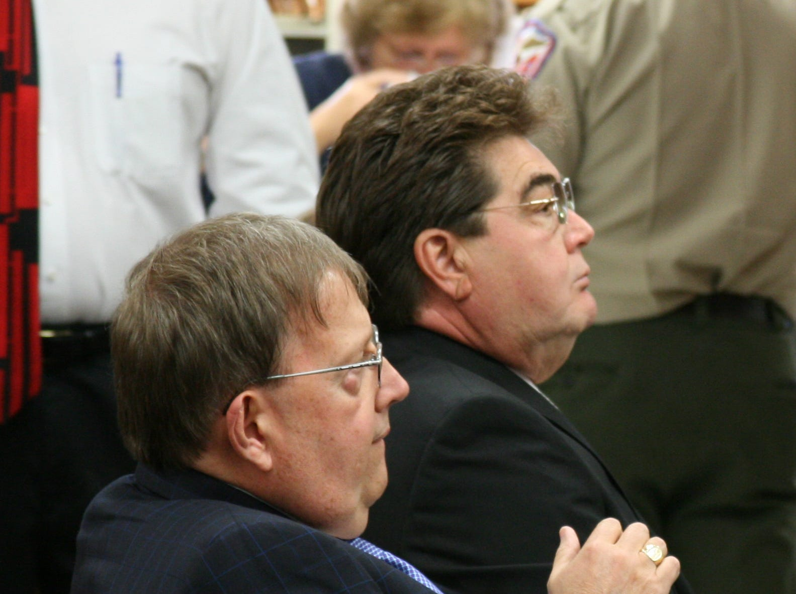 Claiborne County Sheriff David Ray, right, and his attorney, John T. Milburn Rogers, listen to proceedings in Hancock County Criminal Court on Wednesday in Sneedville, Tenn.  Ray was placed on a two-year pre-trial diversion program and ordered to perform 250 hours of community service in connection with sexual assault, statutory rape and statutory rape by an authority figure charges. Ray is accused of raping a girl on a deer-hunting trip in Hancock County in 2006, when she was 17, and on an earlier occasion in 2005, when she was 15.