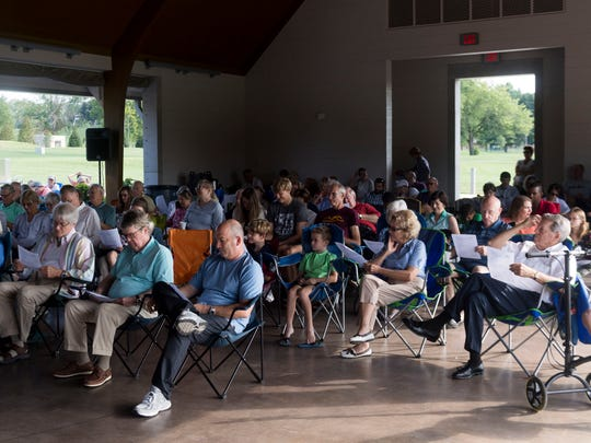 """People fill Lakeshore Park's Marble Hall pavilion for St. John's Episcopal Cathedral's """"Sundays at the Shore"""" service on Sunday, August 5, 2018."""