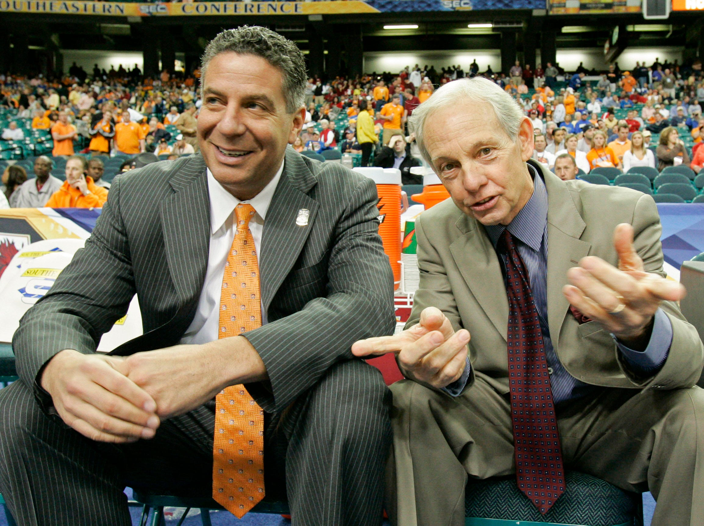 Tennessee coach Bruce Pearl, left, talks with South Carolina coach Dave Odom before the start of their game in the SEC Basketball tournament in the Georgia Dome in Atlanta Friday, March 14, 2008. Odpm has announced he will retire at the conclusion of this season. (AP Photo/Phil Coale)
