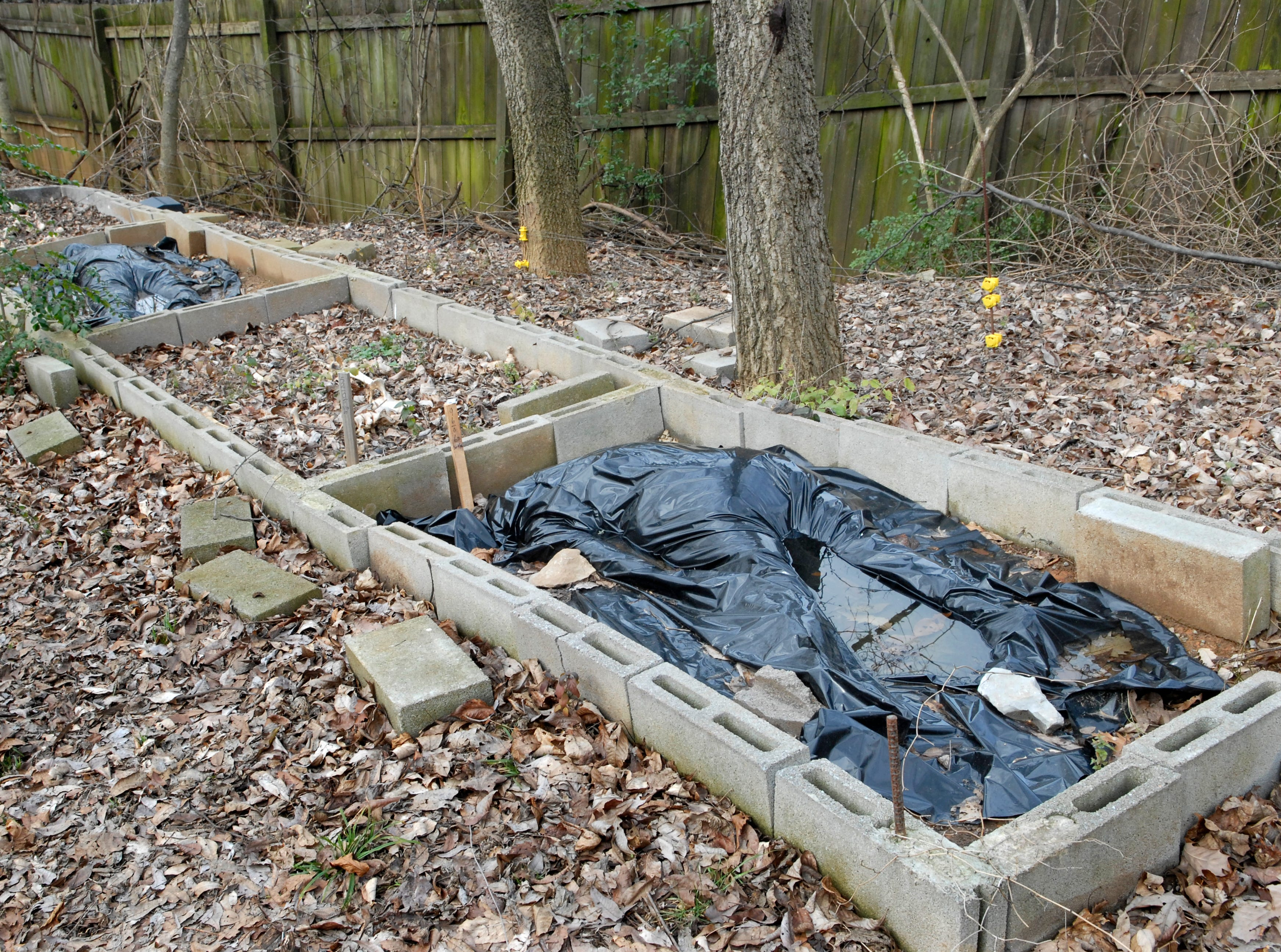 """Bodies lie covered in various stages of decomposition Tuesday inside the Anthropology Research Facility, better known as """"The Body Farm"""" in 2007. With more body donations and an increased amount of research going on at the one-acre facility, the Forensic Anthropolgy Center would like to see an additional 15 acres of land allocated for their research."""