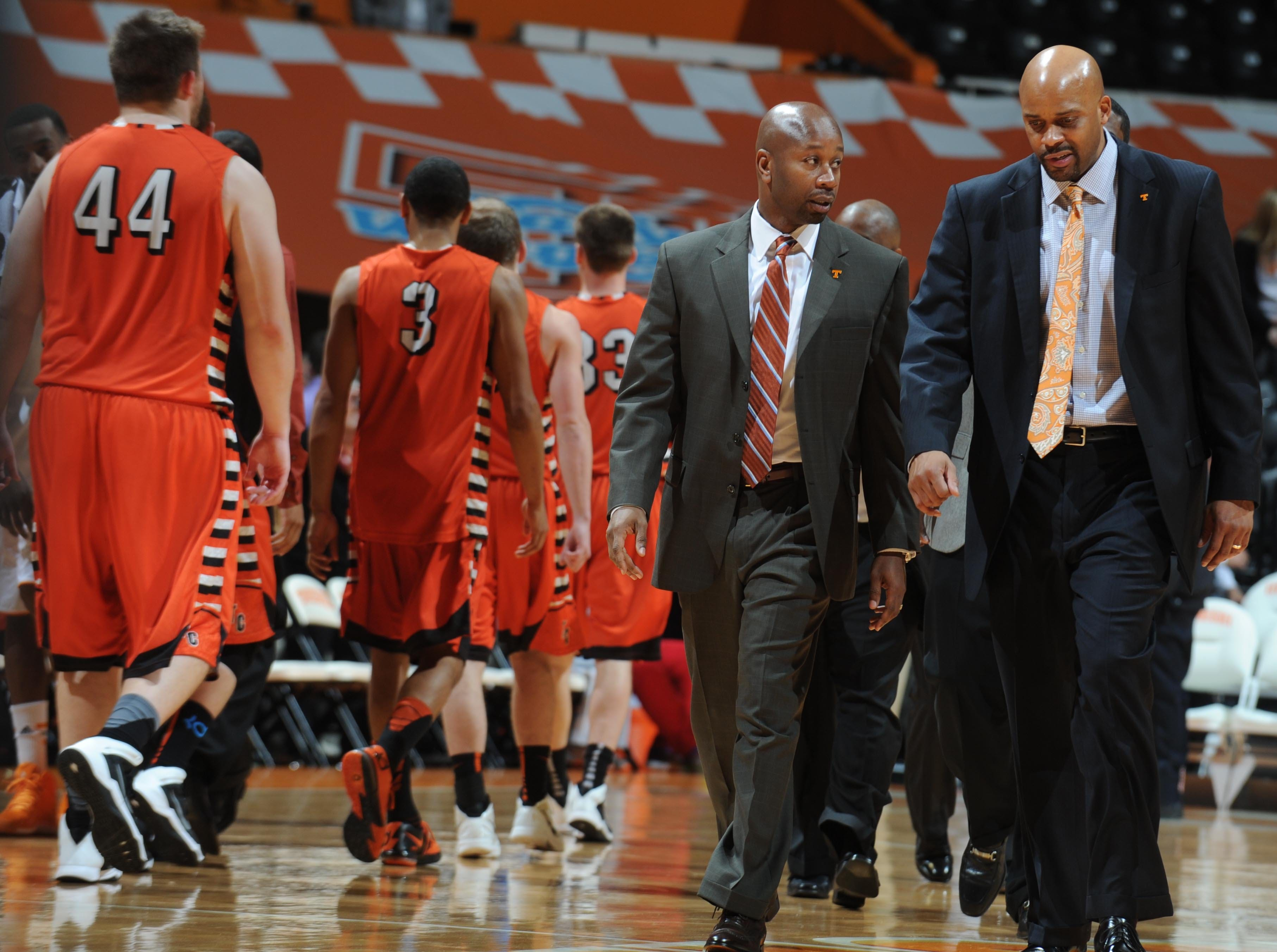 Tennessee head coach Cuonzo Martin, right, leaves the floor with director of basketball operations Marco Harris after defeating Tusculum at Thompson-Boling Arena on Saturday, Jan. 1, 2013.