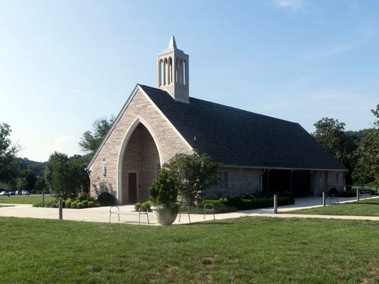 """Lakeshore Park's Marble Hall was once the stone church when the park was the site of the state's Lakeshore Mental Health Institute. Now it hosts St. John's Episcopal Cathedral's weekly """"Sundays at the Shore"""" service from June to August."""
