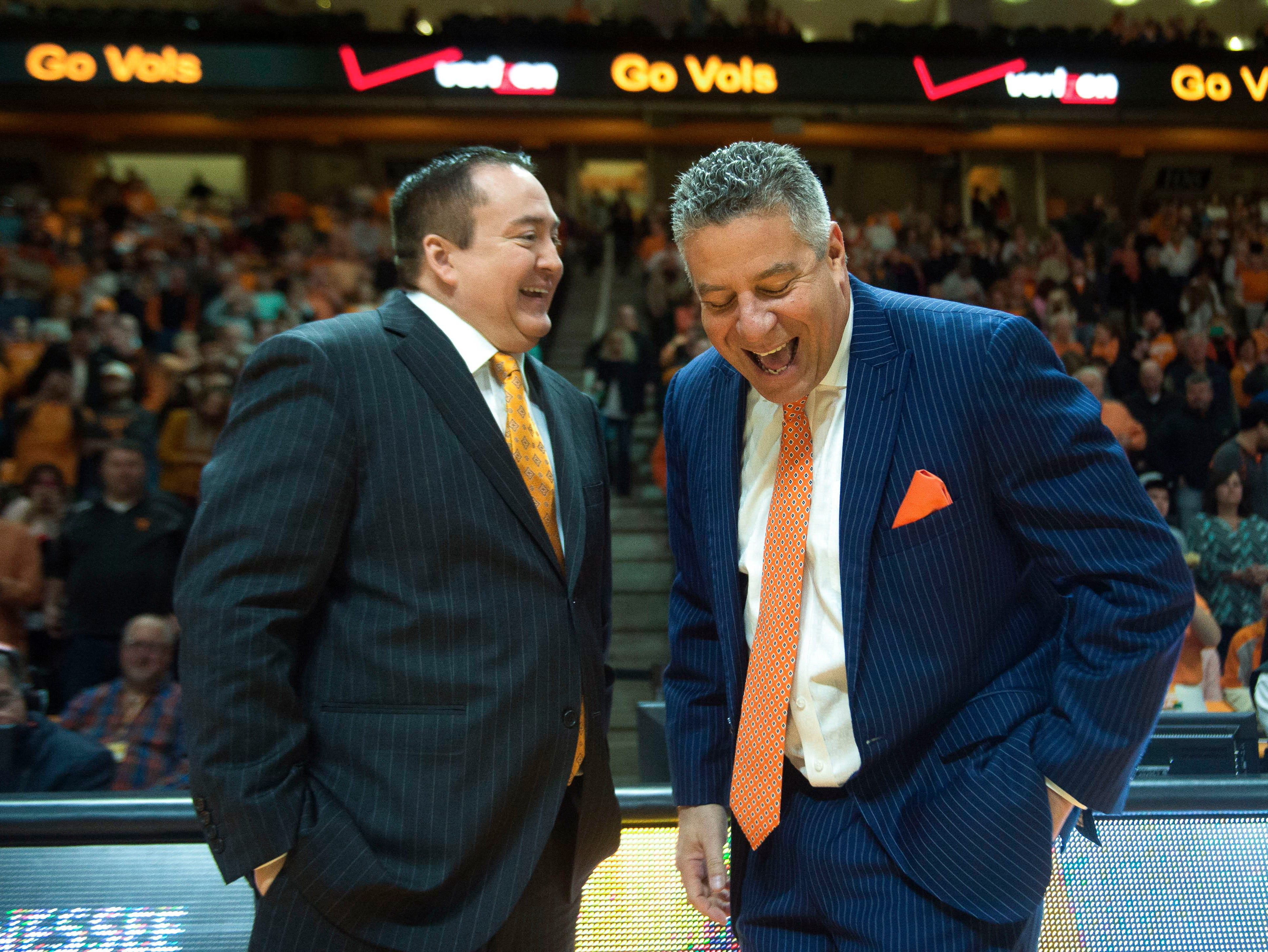 Tennessee head coach Donnie Tyndall and Auburn head coach Bruce Pearl share a laugh at center court before the Tennessee-Auburn game at Thompson-Boling Arena in Knoxville on Saturday, Jan. 31, 2015.