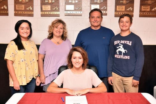 Megann Kiser, seated, with her family at her athletic signing. Pictured are Jordann, mom Neoma, dad Rodney and Jonathan Kiser.