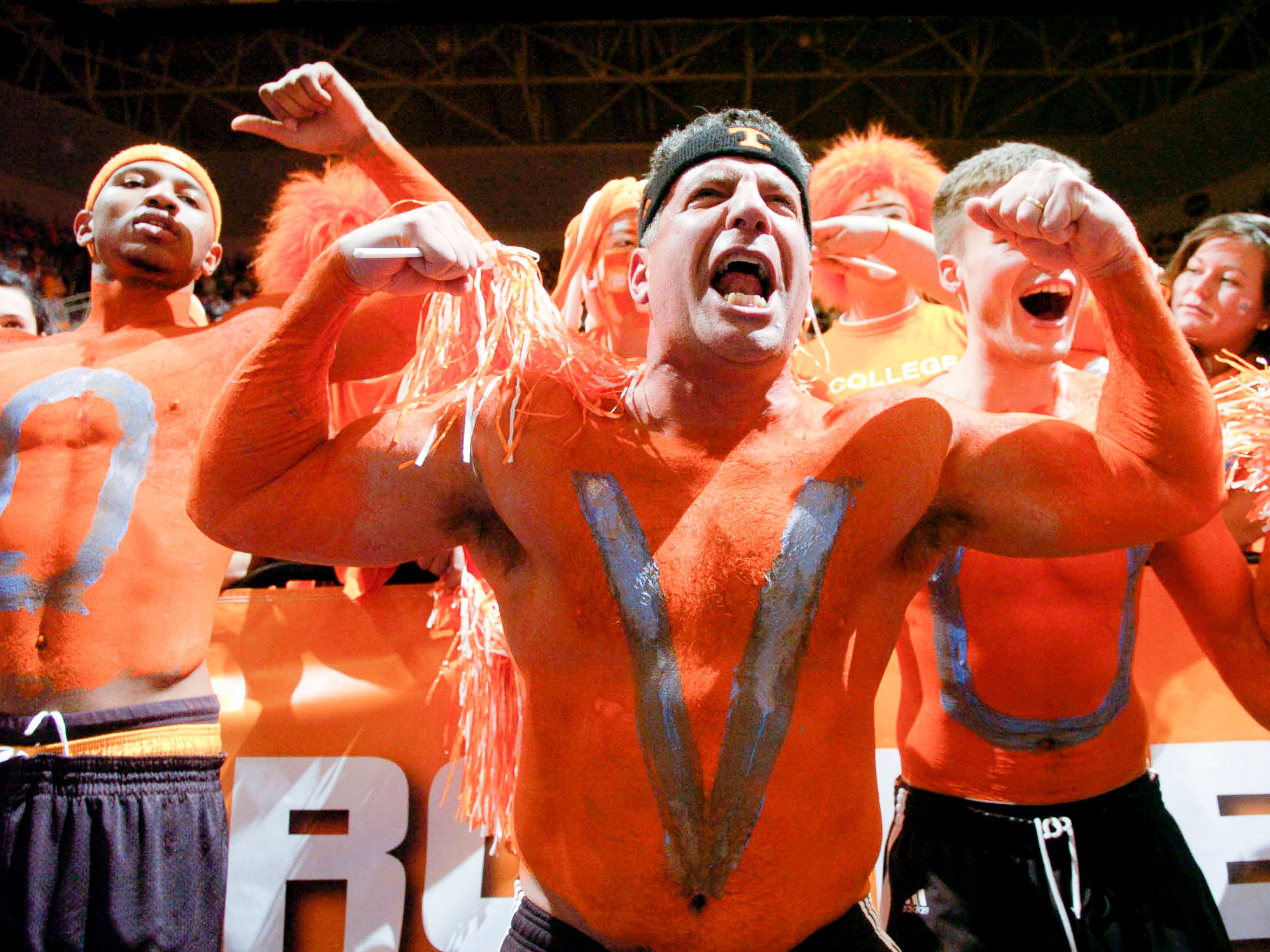 Tennessee men's basketball coach Bruce Pearl is stripped at the waist and painted in orange to cheer on the the Lady Vols just before the start of their game against Duke on Monday, January 22, 2007.