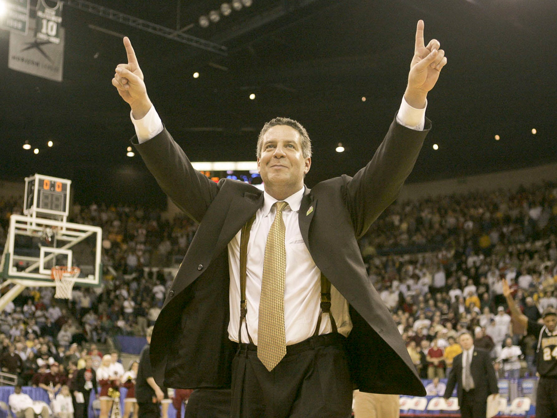 Coach Bruce Pearl celebrates after their victory in their second round game of the NCAA tournament at the Wolstein Center in Cleveland Saturday, March, 19, 2005.