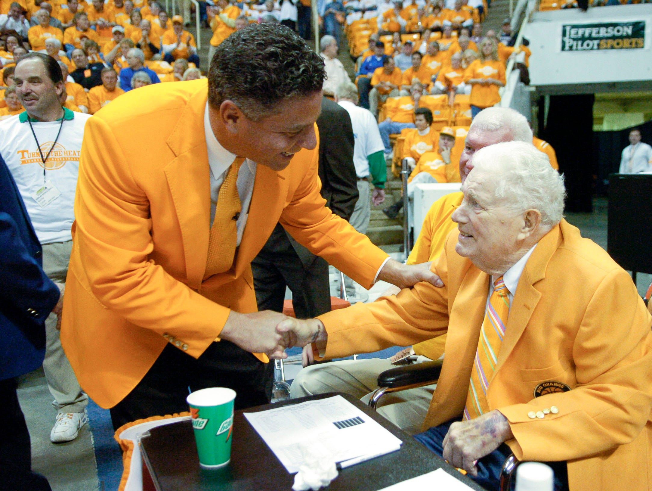Tennessee head coach Bruce Pearl greets former head coach Ray Mears before the game agaisnt Kentucky in 2006.